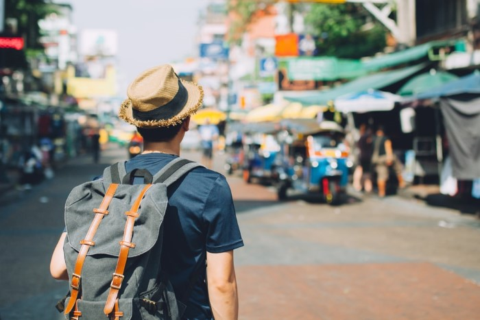 Young-Asian-traveling-Backpacker-in-Khaosan-Road-outdoor-market-in-Bangkok-Thailand_559055305-min (Custom)
